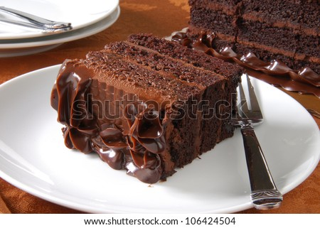 a slice of rich dark chocolate cake - stock photo