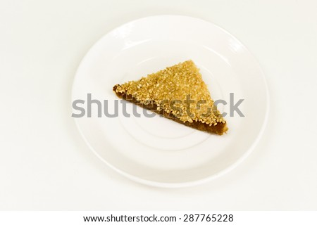 A slice of sesame sandwich on a white plate. - stock photo