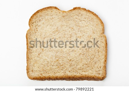 A slice of whole wheat bread against a white background