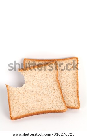 A slice whole wheat bread had bite marks isolated on white background
