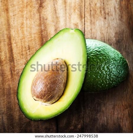 A sliced avocado on a cutting board closeup. fresh ,green avocado - stock photo