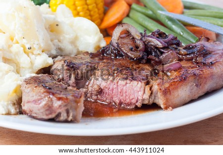 A sliced juicy rump steak cooked to medium - stock photo