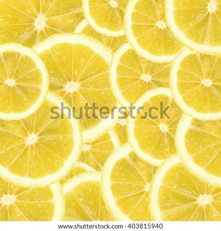 A slices of fresh yellow lemon texture background pattern. Lemon pieces in different sizes background. Texture formed by citrus pieces. - stock photo