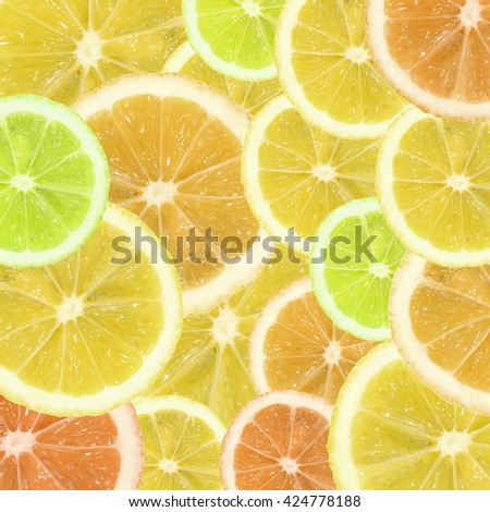 A slices of lemon, orange and lime texture background - stock photo