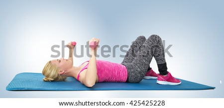 A slim young woman in exercise outfit lying on the floor doing exercises, isolated for white background.  - stock photo