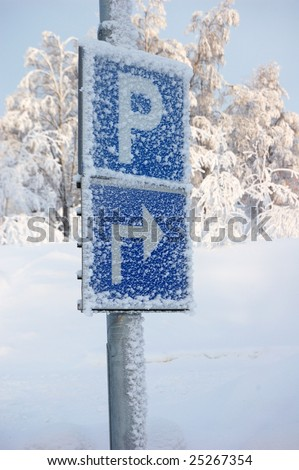 A slippy winterroad in northern Sweden gällivare and parkingsigns.