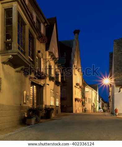 A small alley in a medieval town at night  - stock photo