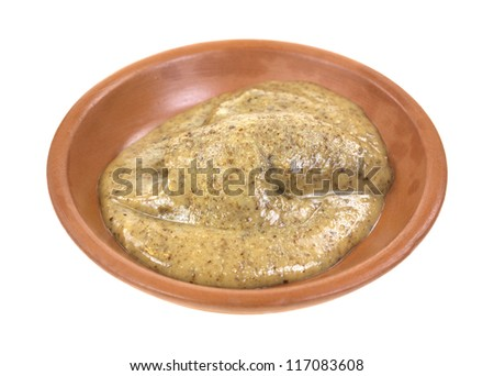 A small amount of all natural almond butter in a red clay dish on a white background. - stock photo
