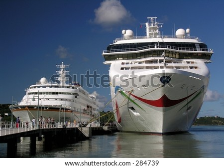 A small and a large cruise ship docking in the port of St. John's / Antigua - stock photo
