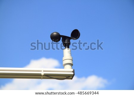 a small anemometer, blue sky in the background