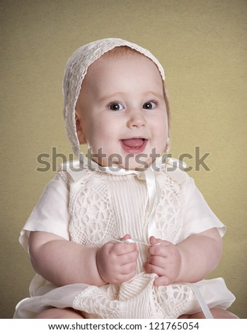a small baby, with her dress to celebrate her christening - stock photo
