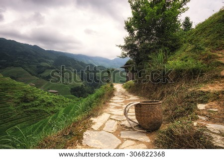 a small basket used by the local farmer laid carefully on the trail leading up to the viewpoint number 2 thousand layers of heaven in longji rice terrace, china