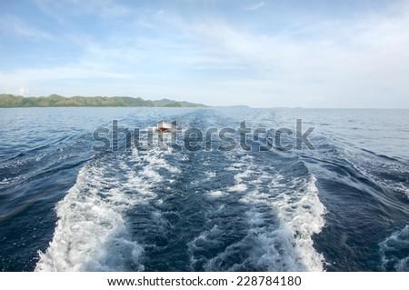 A small boat dragged behind a diving boat, Palawan - stock photo