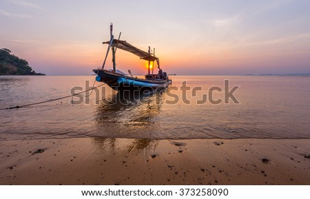 A small boat in sunset time at Ao Yang Beach,Chanthaburi