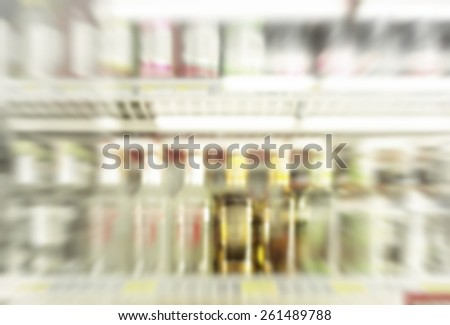 A small bottle whiskey in the mini-mart, blurred image background - stock photo