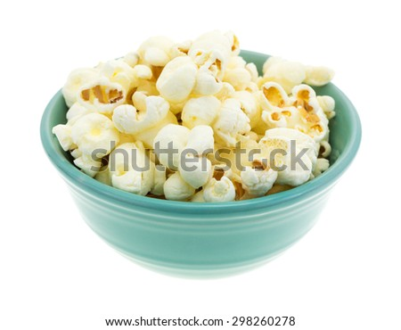 A small bowl filled with a serving of white cheddar cheese flavored popcorn isolated on a white background. - stock photo