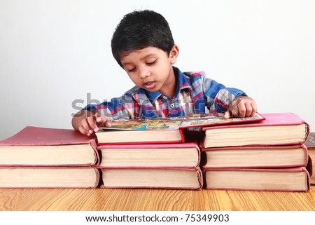 A small boy reading a book