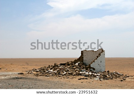 A small building in ruins - stock photo