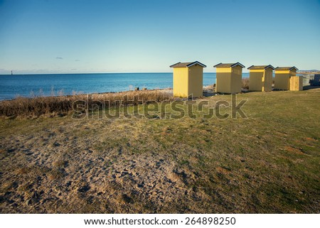 a small buildings on the beach - stock photo