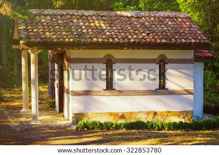 A Small Chapel in the Forest - stock photo