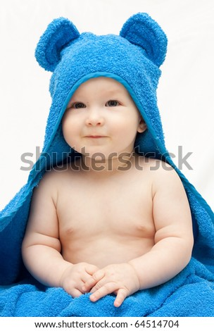 a small child dressed in a bear costume - stock photo