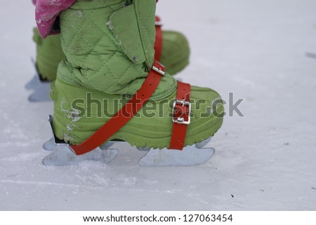 A small child's first pair of double ice skates
