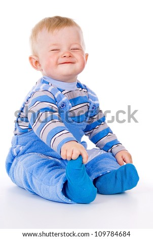A small child sits and laughs isolated on white background - stock photo