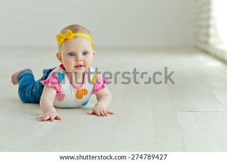 A small child sitting on the floor
