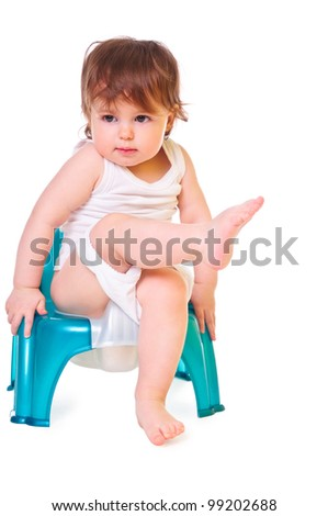a small child sitting on the pot. isolated on white. high-key - stock photo
