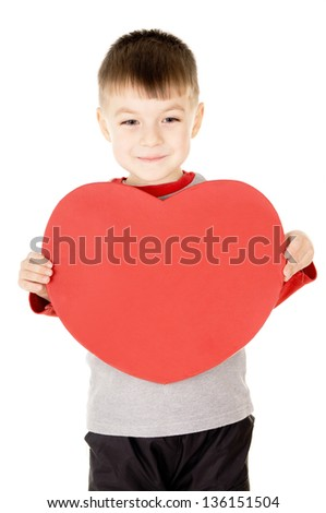 a small child stands and holds the heart isolated on white background - stock photo