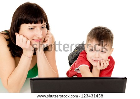 a small child with her mother watch the movie the notebook isolated on white background - stock photo