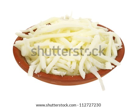 A small clay bowl filled with low fat mozzarella cheese on a white background. - stock photo
