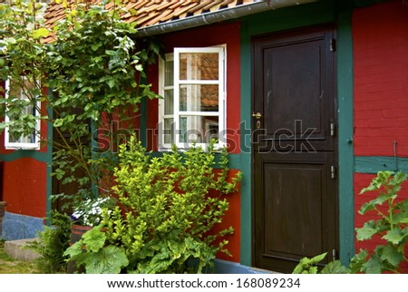 A small danish townhouse with lush inner garden. - stock photo