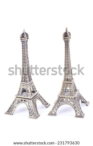 a small eiffel tower reproduction isolated over a white background - stock photo