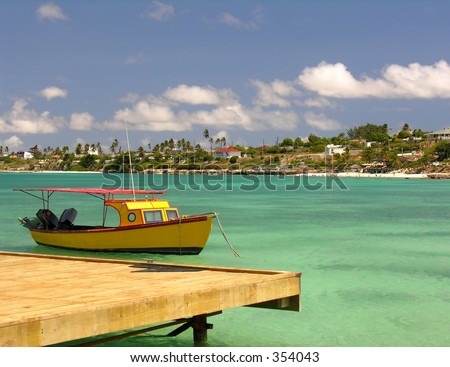 A small fishing boat with a footbridge... - stock photo