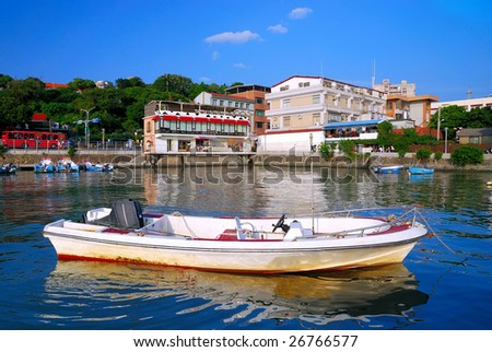 A small fishing port by the riverside of Tamshui in Taiwan. - stock photo