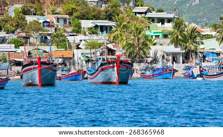 A small fishing village with a lot of fishing boats view from the sea at Nha Trang. Nha Trang is the most beautiful city with a long beach of Khanh Hoa province, Vietnam