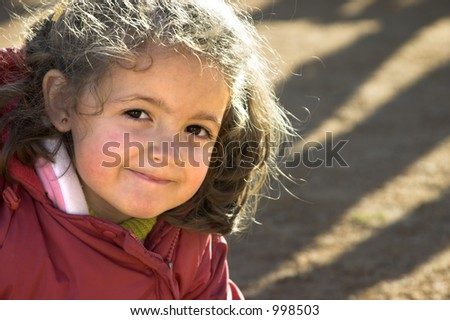 A small girl smiling.