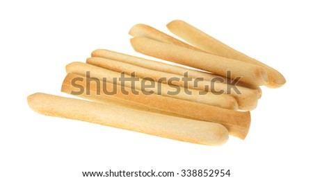 A small group of crunchy breadsticks isolated on a white background. - stock photo