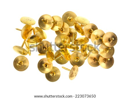 A small group of gold thumbnail tacks on a white background. - stock photo