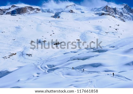 A small group of skiers ascends to the Monte Rosa Hut near Zermatt, Switzerland - stock photo