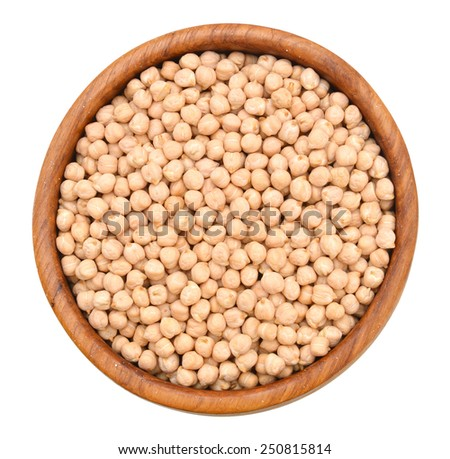 A small handful of chick-pea in wood bowl. Beans isolated on a white background. Close-up.  - stock photo