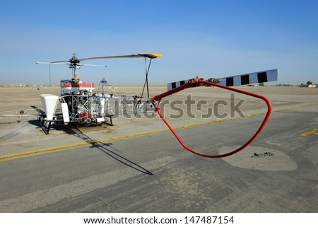 A small helicopter has been converted for use in aerial applications for Central California farms - stock photo