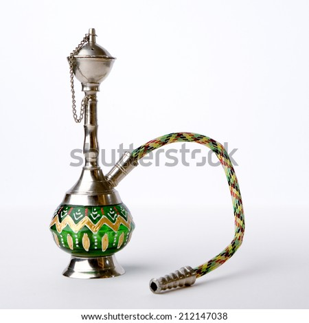 A small hookah pipe, also known as a shisha, isolated against a white background. - stock photo