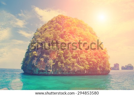 A small island in the tropical sea - stock photo
