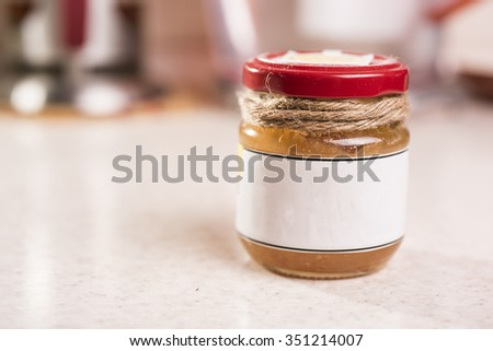 A small jar of jam close up.