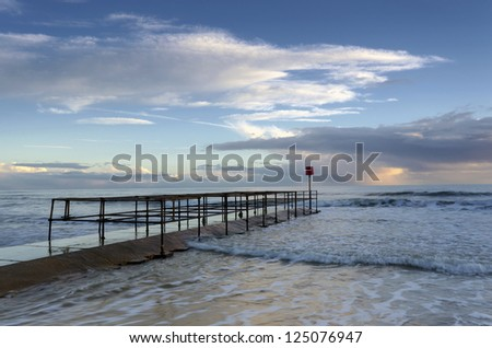 A small jetty on the beach at Boscombe near Bournemouth in Dorset