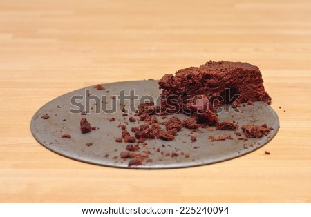A small leftover slice of chocolate brownie cake - stock photo