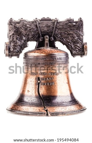 a small liberty bell reproduction isolated over a white background - stock photo