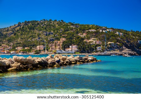 a small mole made of stones at the Port de Soller, Majorca, Spain - stock photo